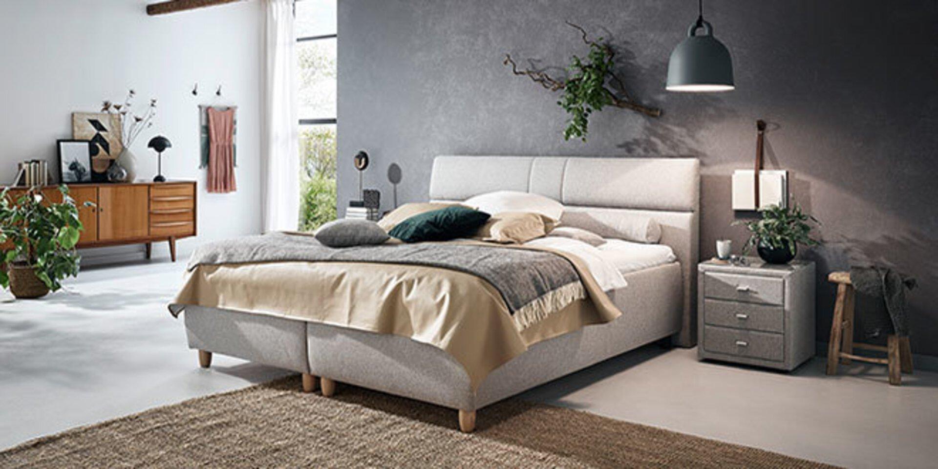 graues Polsterbett von ADA las Titelbild für die Marke