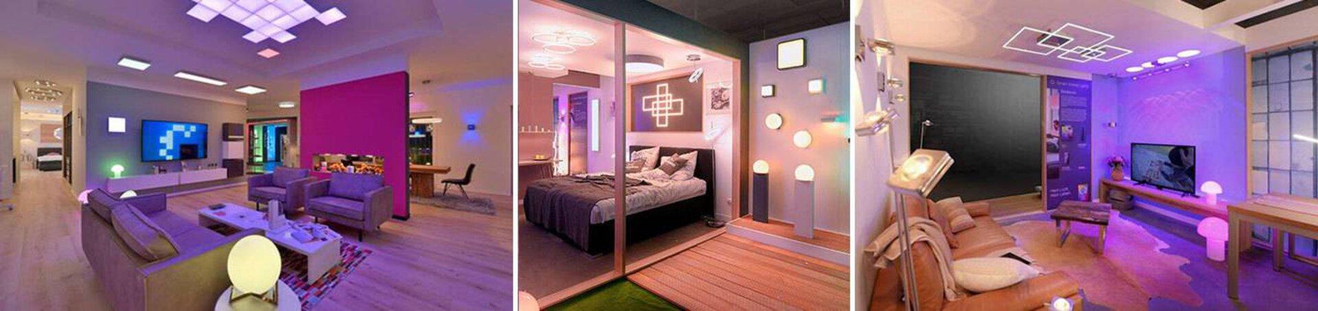 Wohnbereich in buntes Licht getaucht, dank smarter Leuchten. Der Bildbanner dient als Inspiration für Smarte Leuchten innerhalb der Leuchtentrends.