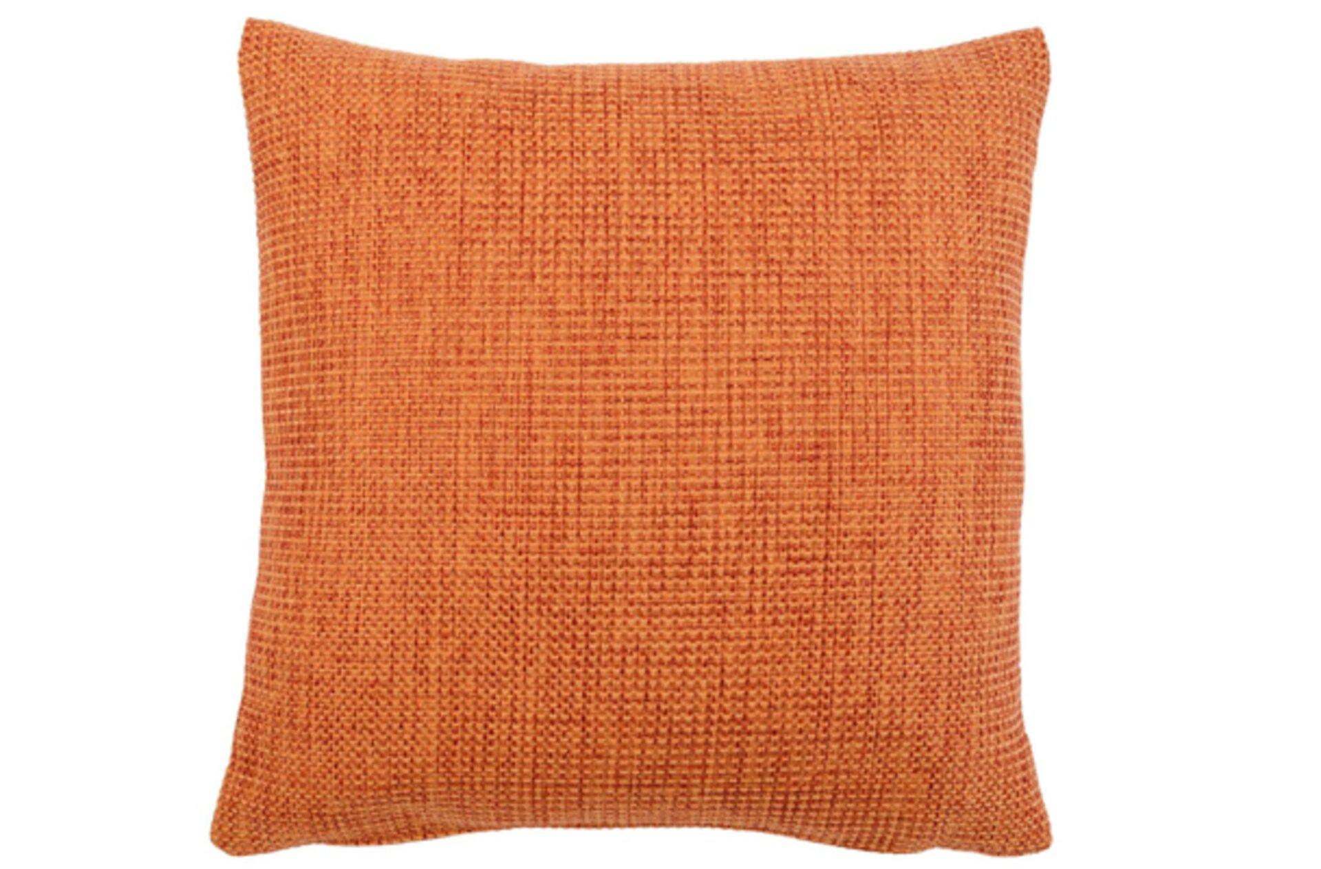 Oranges Kissen als Beispiel für Komplementärfarbe