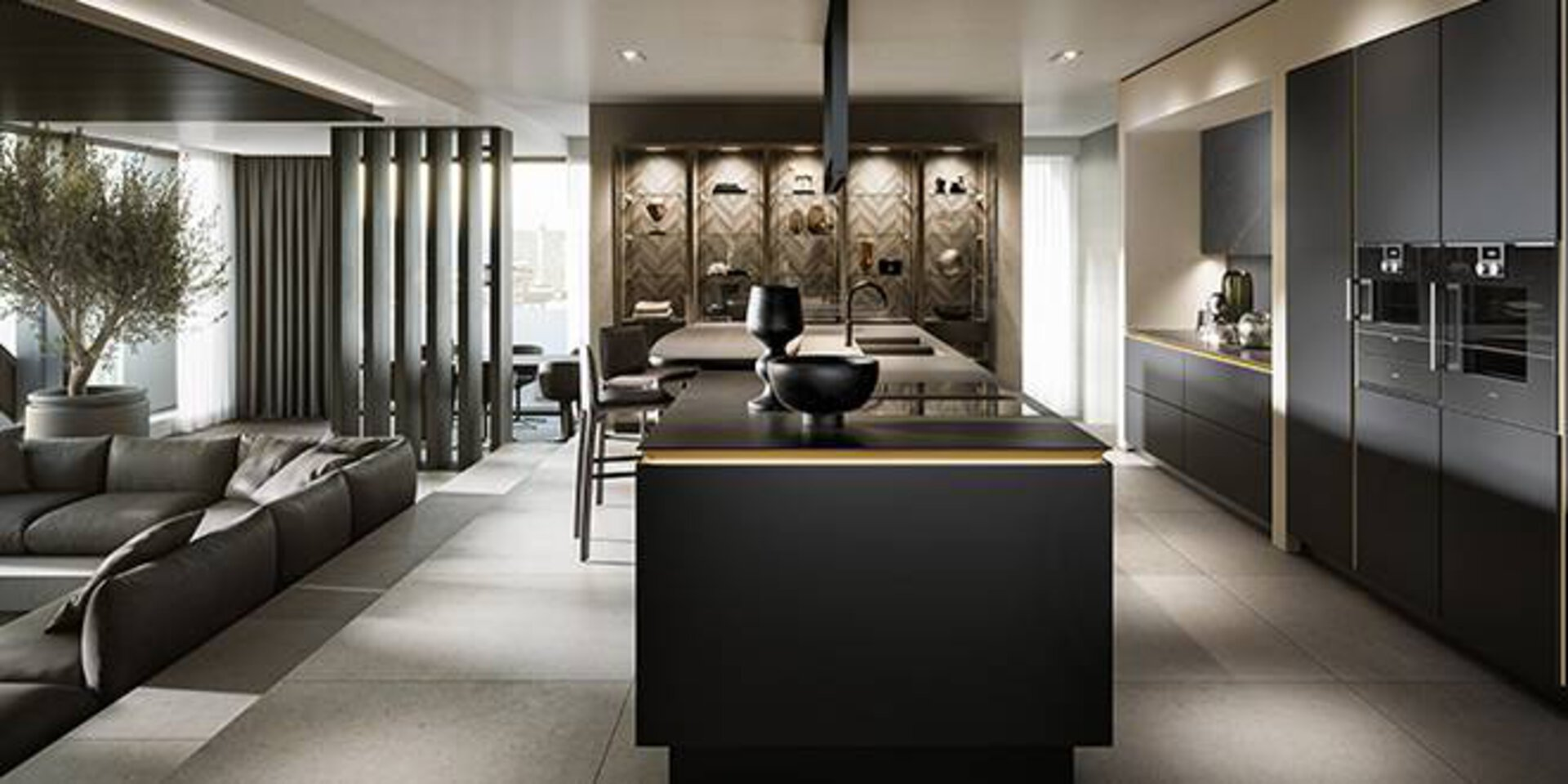 Premiumküche von SieMatic. Abgebildet ist die neue SLX Ausfürhrung, die bereits mit dem German Design Award 2021 ausgezeichnet wurde. Die dunkel gehaltene Küche wird von einer edlen Kücheninsel dominiert.