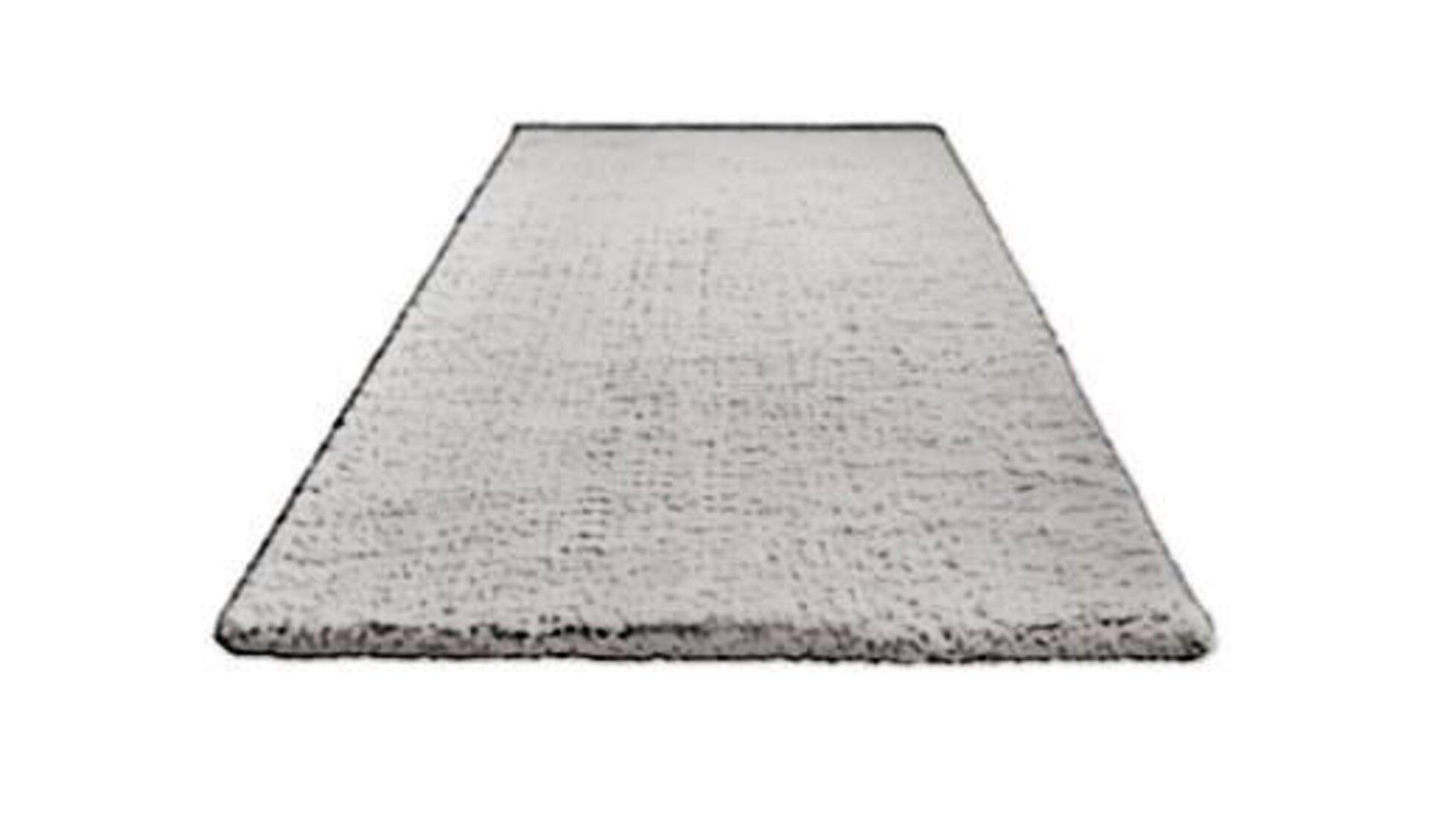 Icon für Hochflorteppich zeigt einen weichen Teppich in hellem Grau.